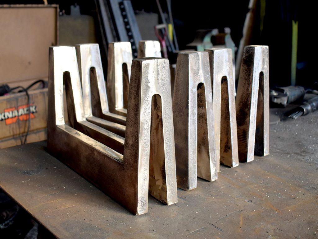 Bronze sand cast andirons.