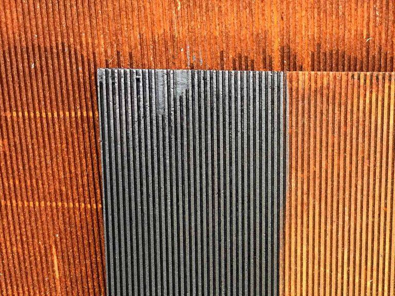 Blackened rust patina finish.