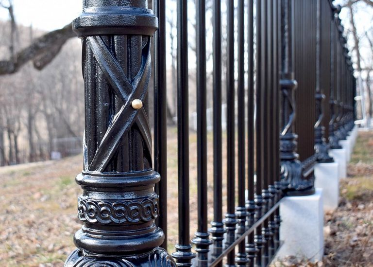 Reproduction cast iron fence post base at Monticello.