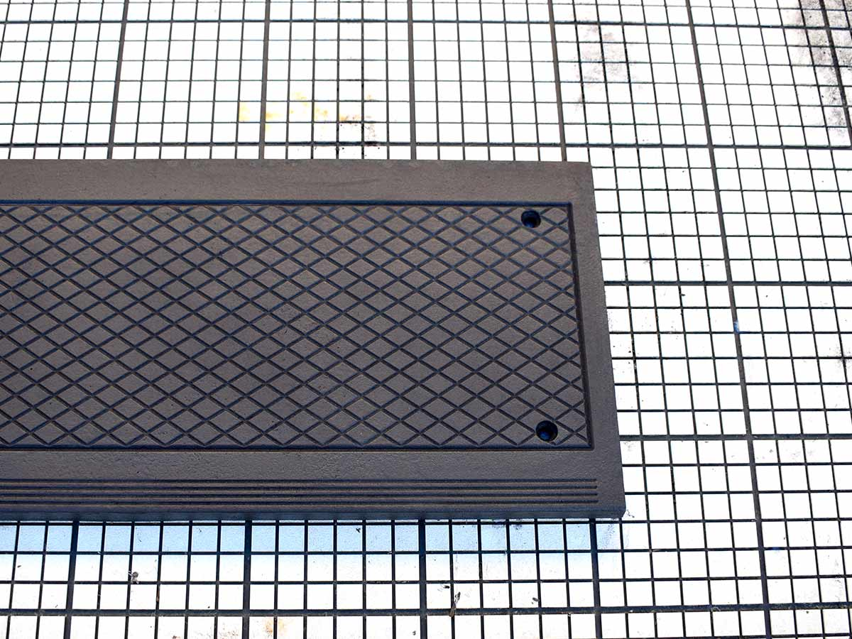 Cast iron stair tread, diamond relief pattern.